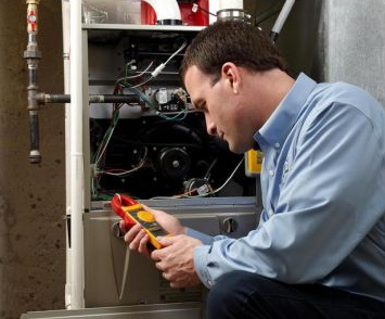 Professional Technician Doing Furnace Inspection